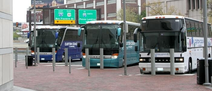 Three buses parked by the curb