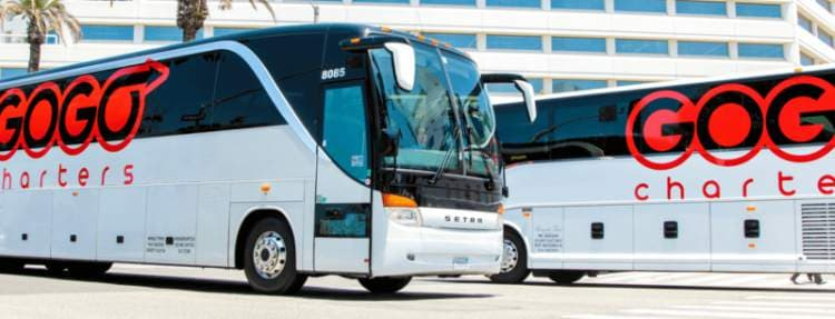 GOGO Chaters motorcoaches idling in a parking lot.