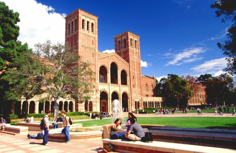 Students sitting on UCLA campus on a sunny day