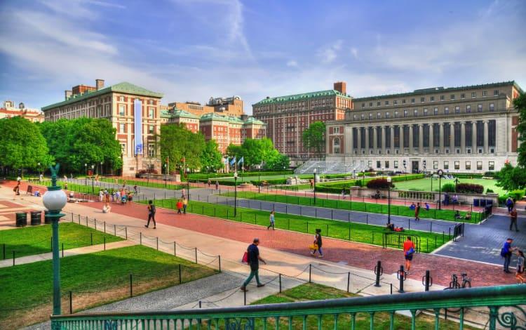 students walk around Columbia University in New York City