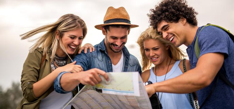 A group of tourists looking at a map