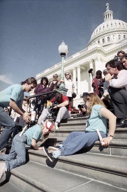 protesters crawl up the steps of the U.S. capitol at the capitol crawl