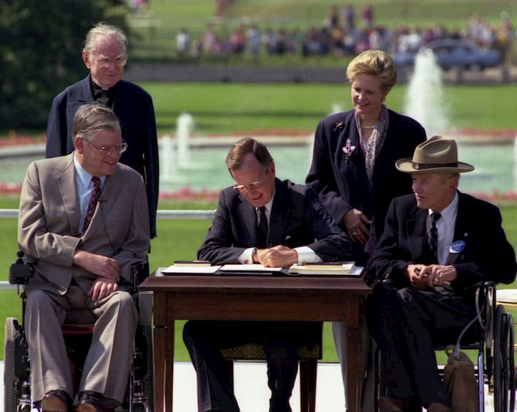 george hw bush signs the americans with disabilities act into law