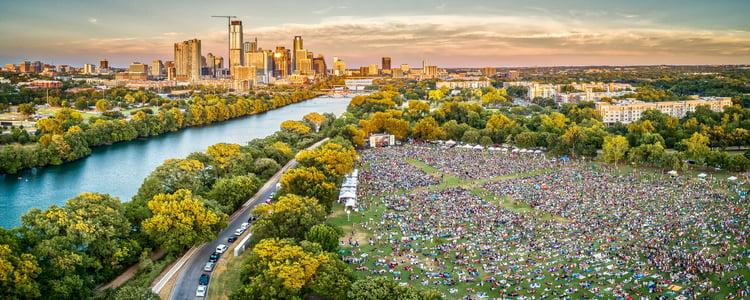 birdeye view of a riverside festival in Austin TX