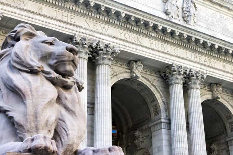 majestic lion statue outside of the new york public library main entrance