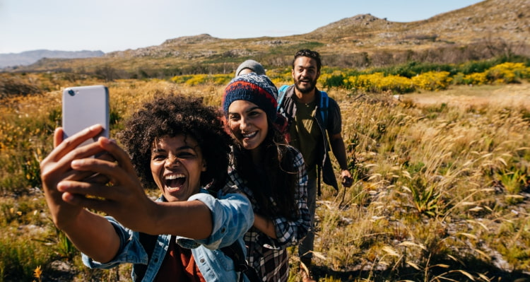 a los angeles hiking group stops for a selfie
