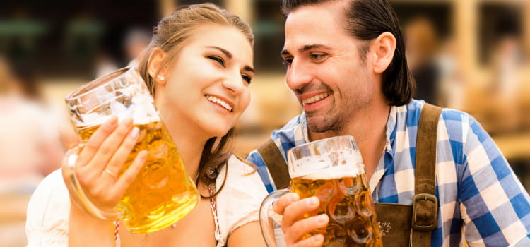 young couple drinking at oktoberfest