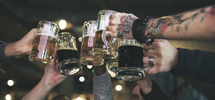 group of people toasting beers