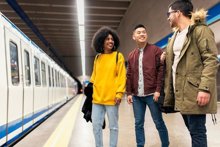 three friends waiting for a train