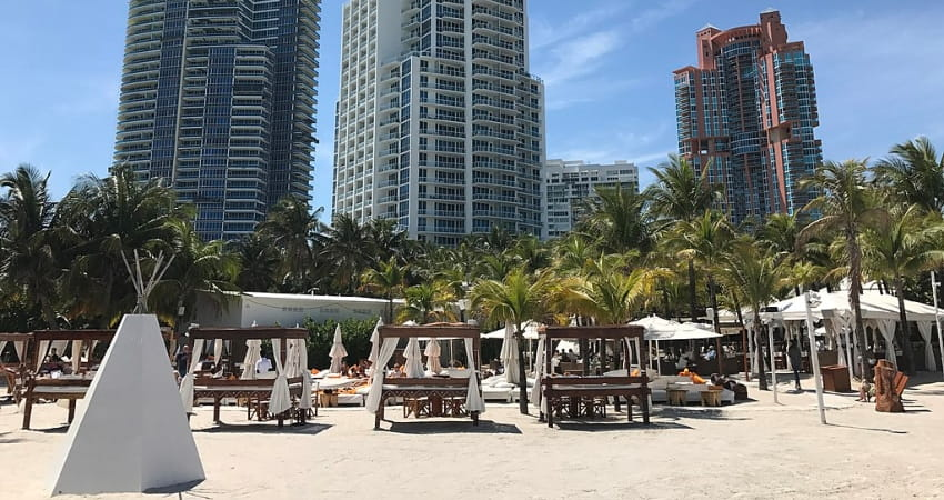 nikki beach club on south beach with skyscrapers in the background