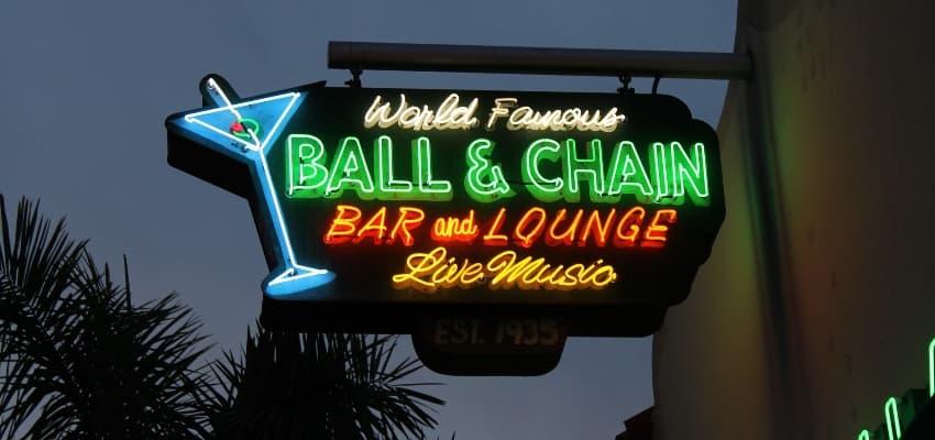 fluorescent sign outside of ball & chain miami