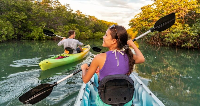 a group kayaks thorugh mangroves in the Florida Keys