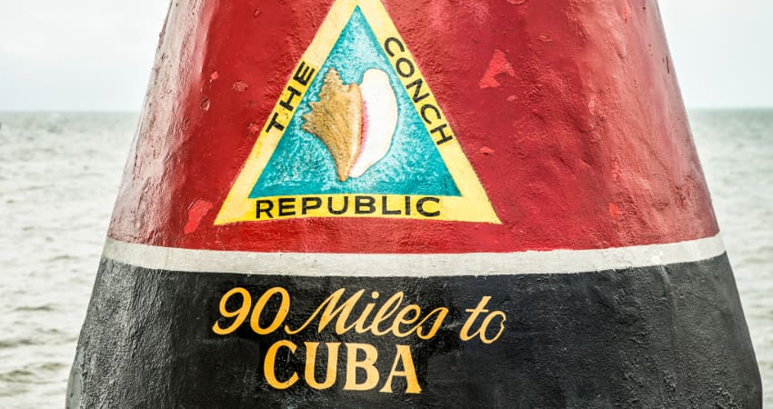 "the painted stone that marks the southernmost point of the contiguous United States, which reads ""The Conch Republic, 90 miles to Cuba"""