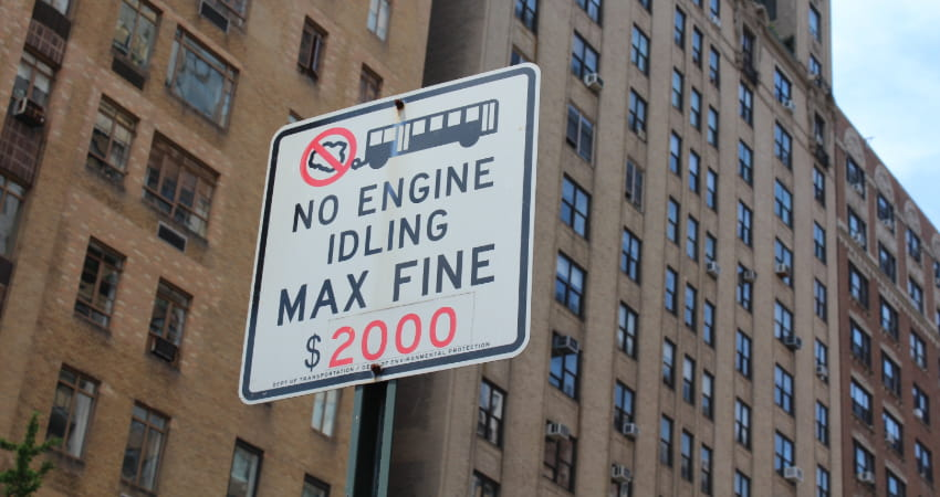 "a sign in a city reads ""no engine idling max fine $2000"""