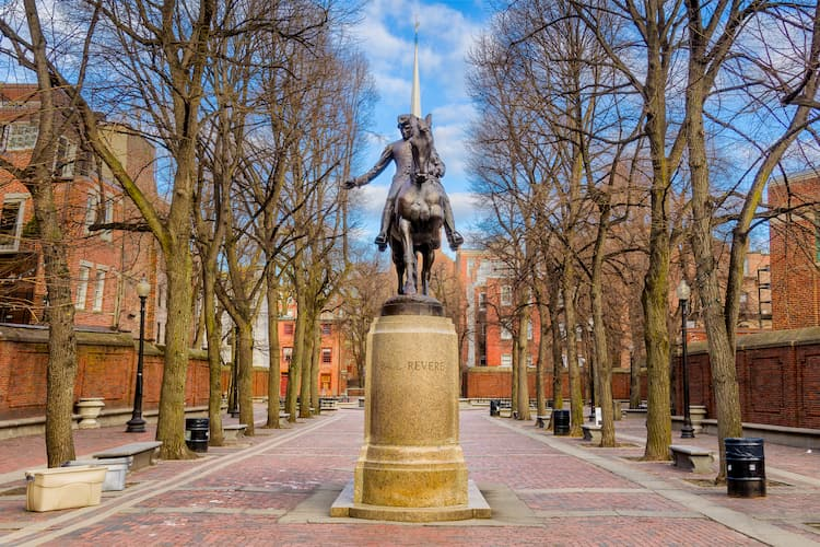 a statue of paul revere on his horse on boston's freedom trail