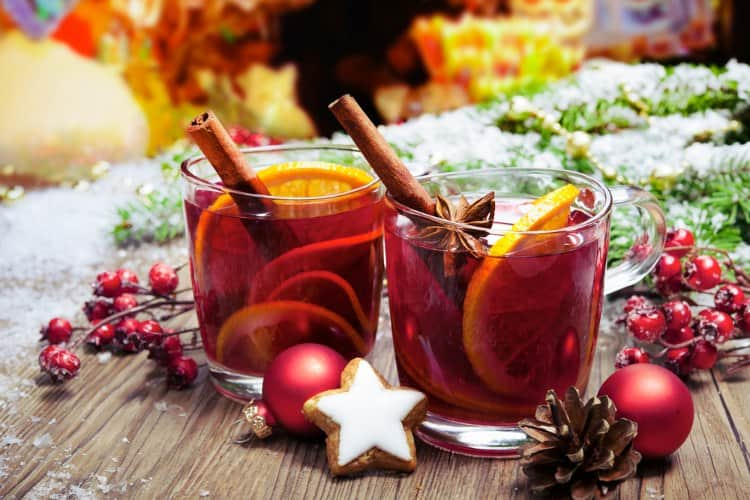 christmas-themed drinks with cinnamon sticks at Denver's christkindl market
