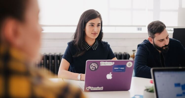 a woman plans a corporate team-building event