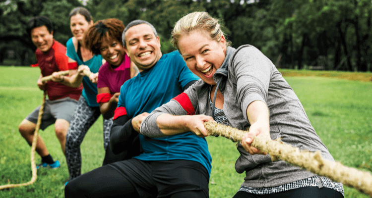 team members play tug-of-war during a team-building event
