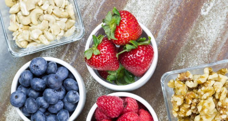 some snack ideas for a long bus ride-- cashews, strawberries, blueberries, and walnuts