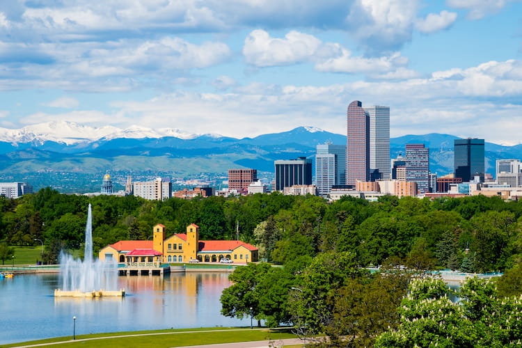 a view of Denver with the mountains in the background