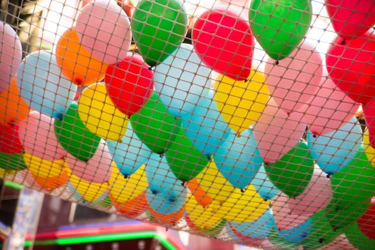 A net filled with balloons at a celebration.