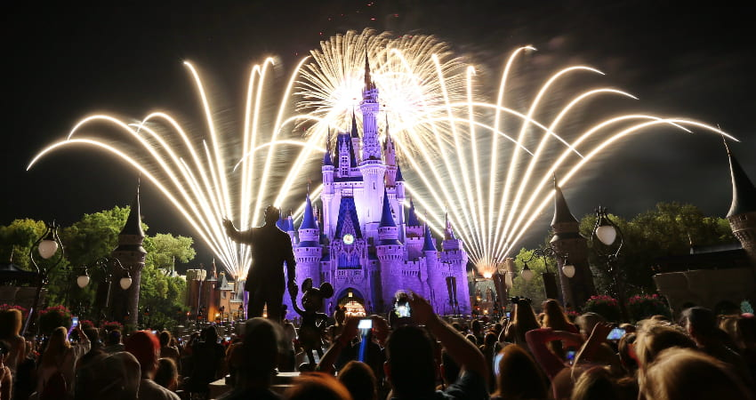 the firework display at Disney World, with the castle illuminated by the explosions