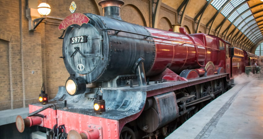 the Hogwarts Express train pulls into the station at The Wizarding World of Harry Potter