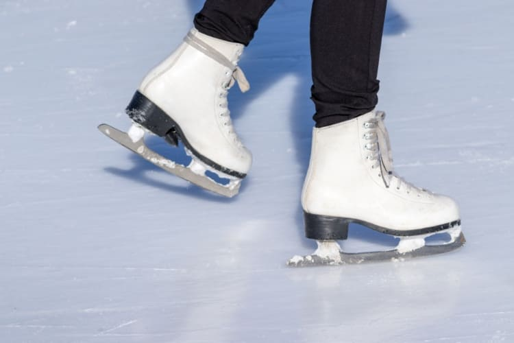 a pair of ice skates on ice at washington harbour ice rink