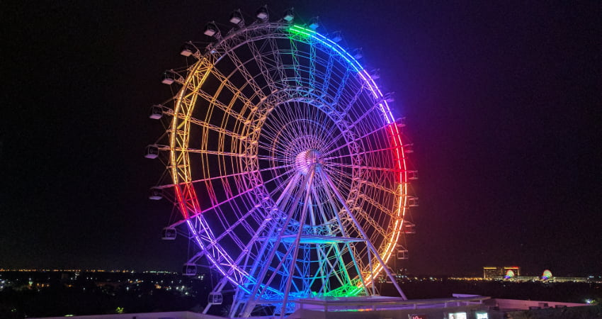 The Orlando Eye Ferris Wheel alight in rainbow colors on New Years Eve