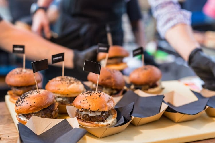 delicious burger sliders laid out at a san antonio food festival