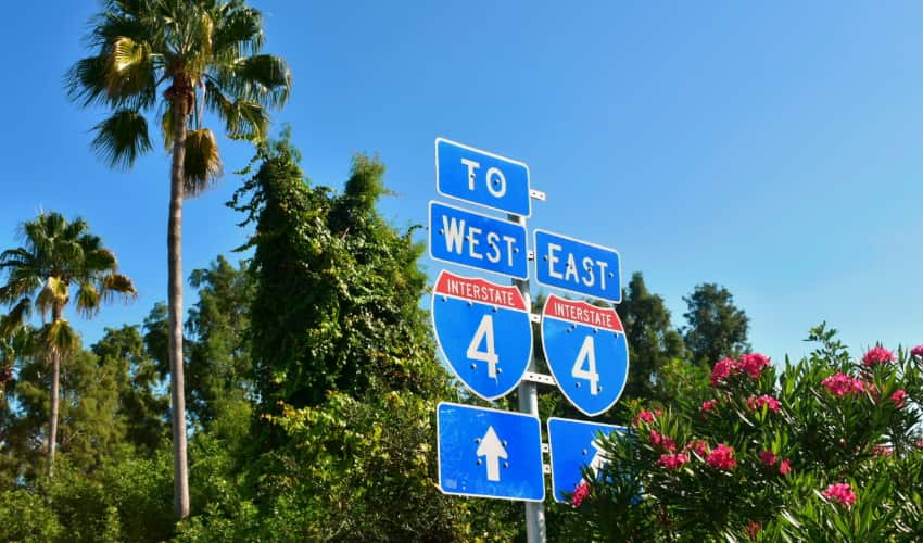The Interstate 4 highway signs in Florida among some greenery