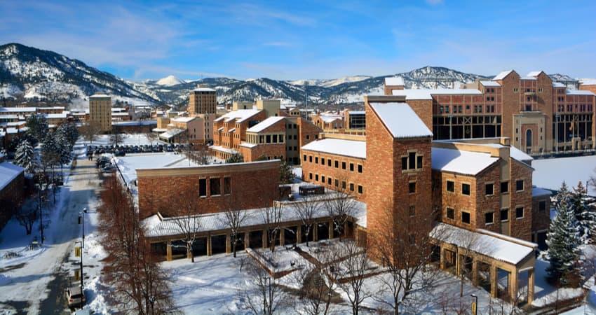 the university of colorado boulder campus with snow