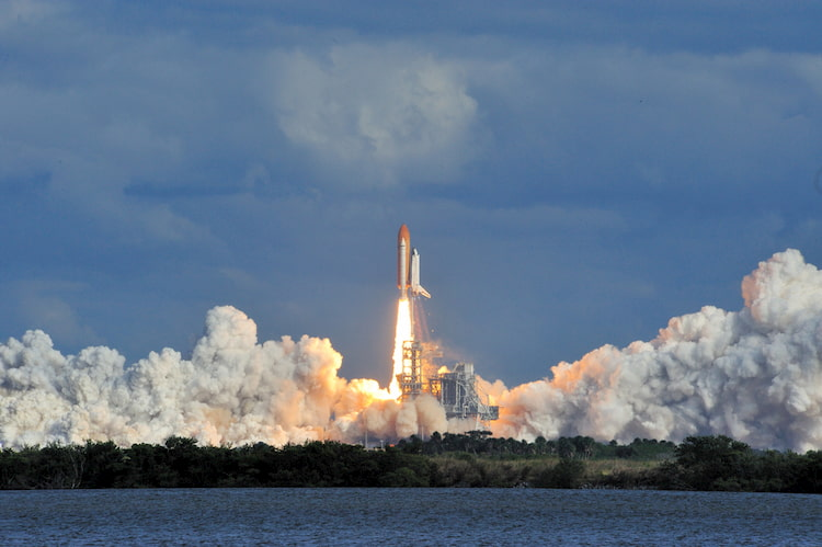 space shuttle atlantis launches from the kennedy space center