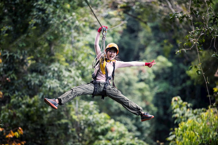 Woman Tourist On Zip Line