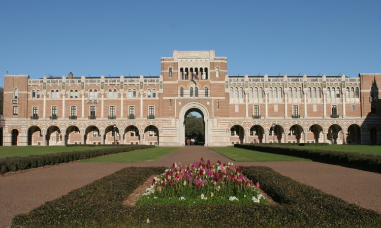 exterior of a Rice University building from the green space in front of it