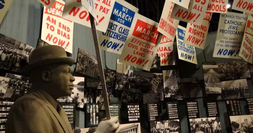 An exhibit of protestors holding signs at the National Civil Rights Museum in Memphis.