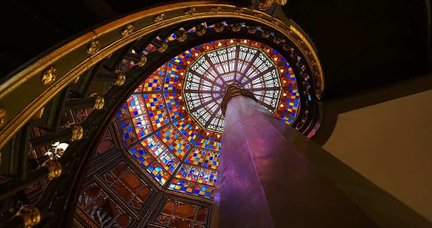 A spiral staircase leading up to the stained glass dome of Louisiana's Old State Capitol.