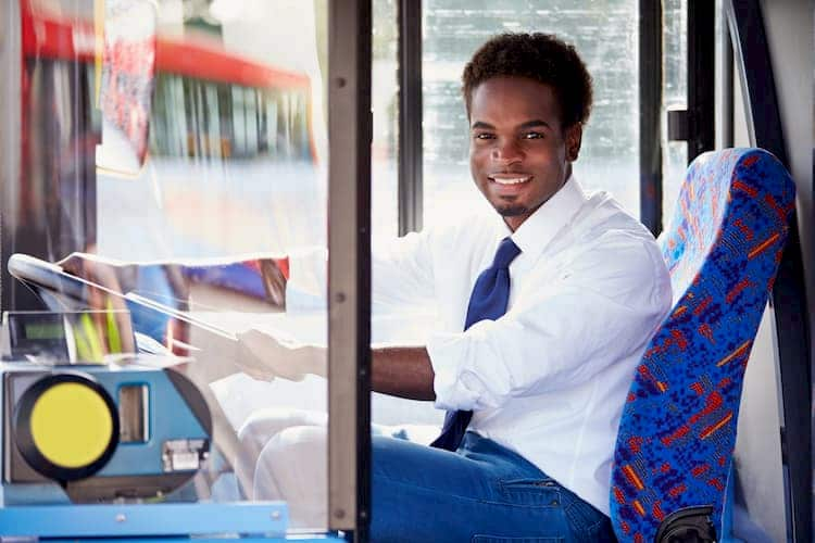 Man driving bus and smiling