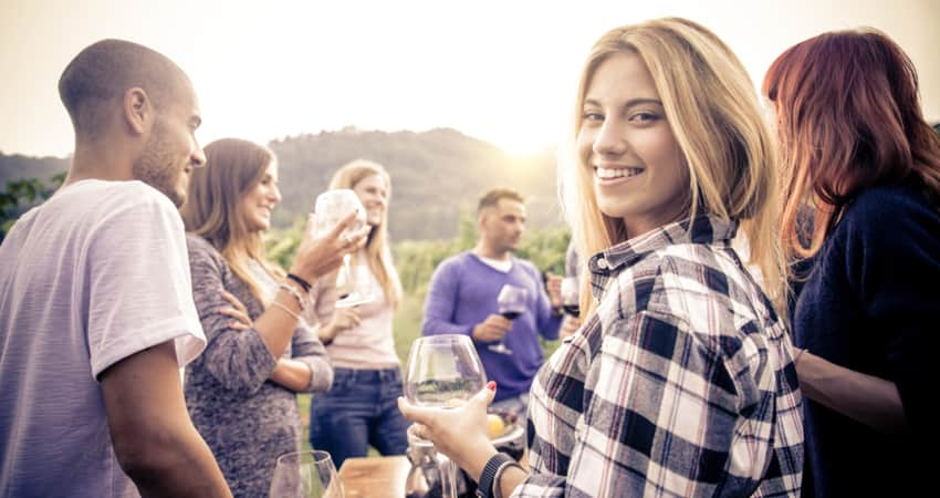A group of friends having wine in Temecula Wine Country
