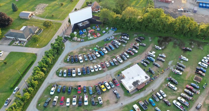 aerial view of a drive-in theatre lot full of cars