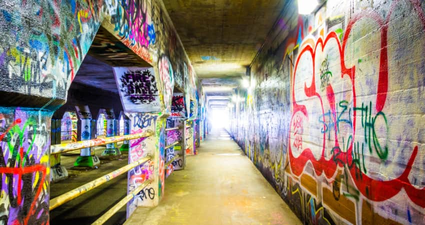 interior of the Krog Street Tunnel, lined with graffiti