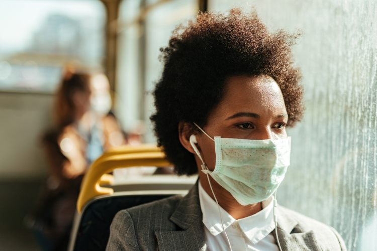 Woman wearing mask on bus
