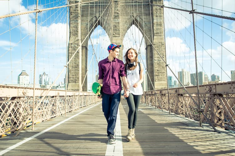 Couple walking on Brooklyn Bridge