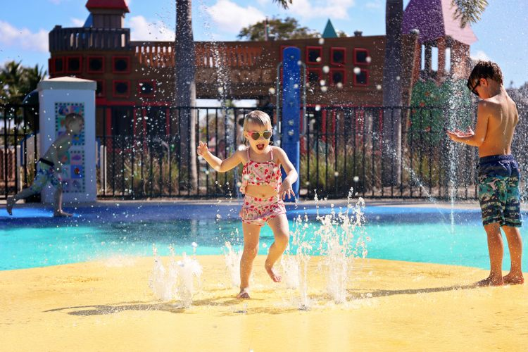 Kid playing in splash pads