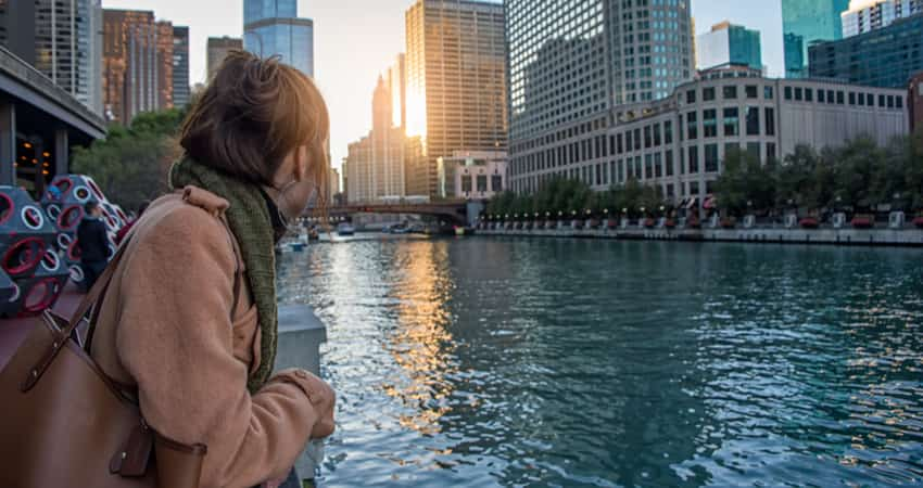 A woman looking at the Chicago River