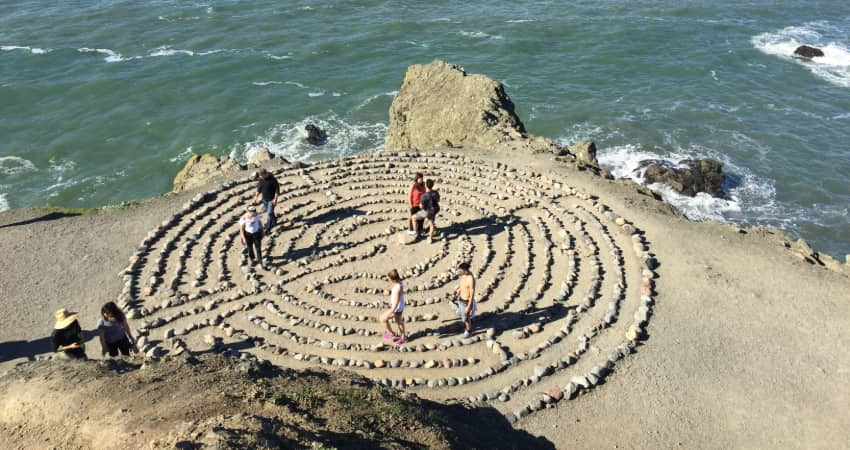 Hikers navigate the rock labyrinth in Land's End Park in San Francisco