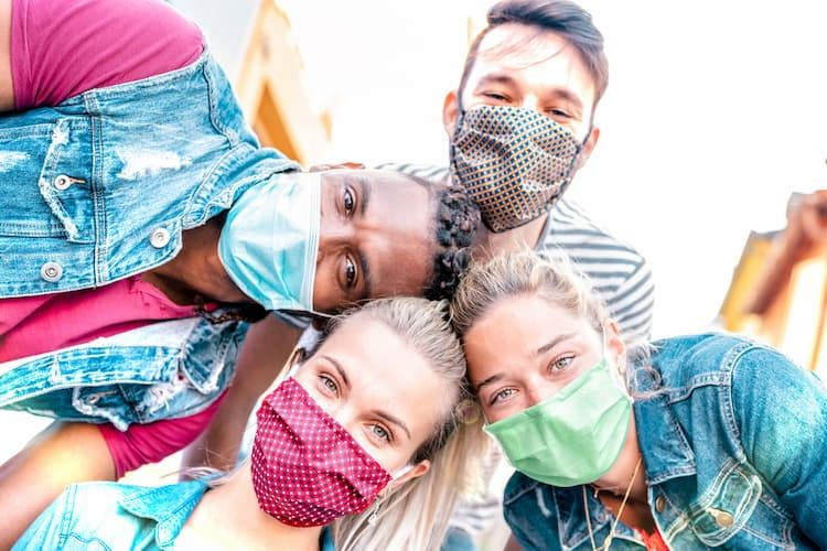 Friends smiling in masks