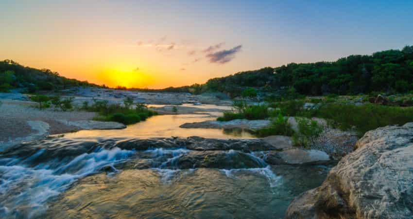 The sunset over Pedernales River Waterfall at Pedernales State Park
