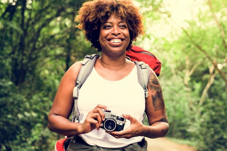 Woman hiking with camera