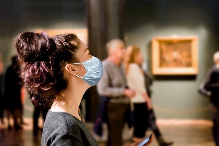 Woman wearing mask in museum